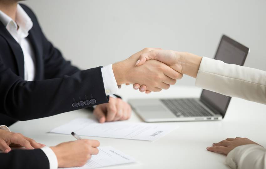 hr-handshaking-successful-candidate-getting-hired-new-job-closeup